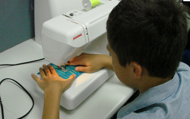 Boy-sewing
